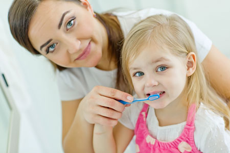 Mom and Daughter brushing their teeth - Pediatric Dentist in Sandpoint, ID